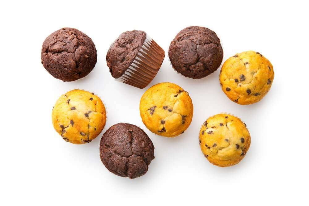 A selection of chocolate chip muffins on a white background
