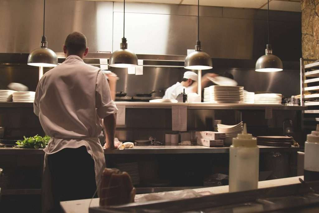 Chefs in kitchen - catering cost savings